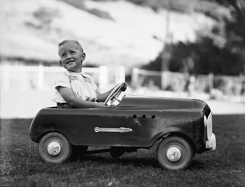 Ian Armstrong in a pedal car